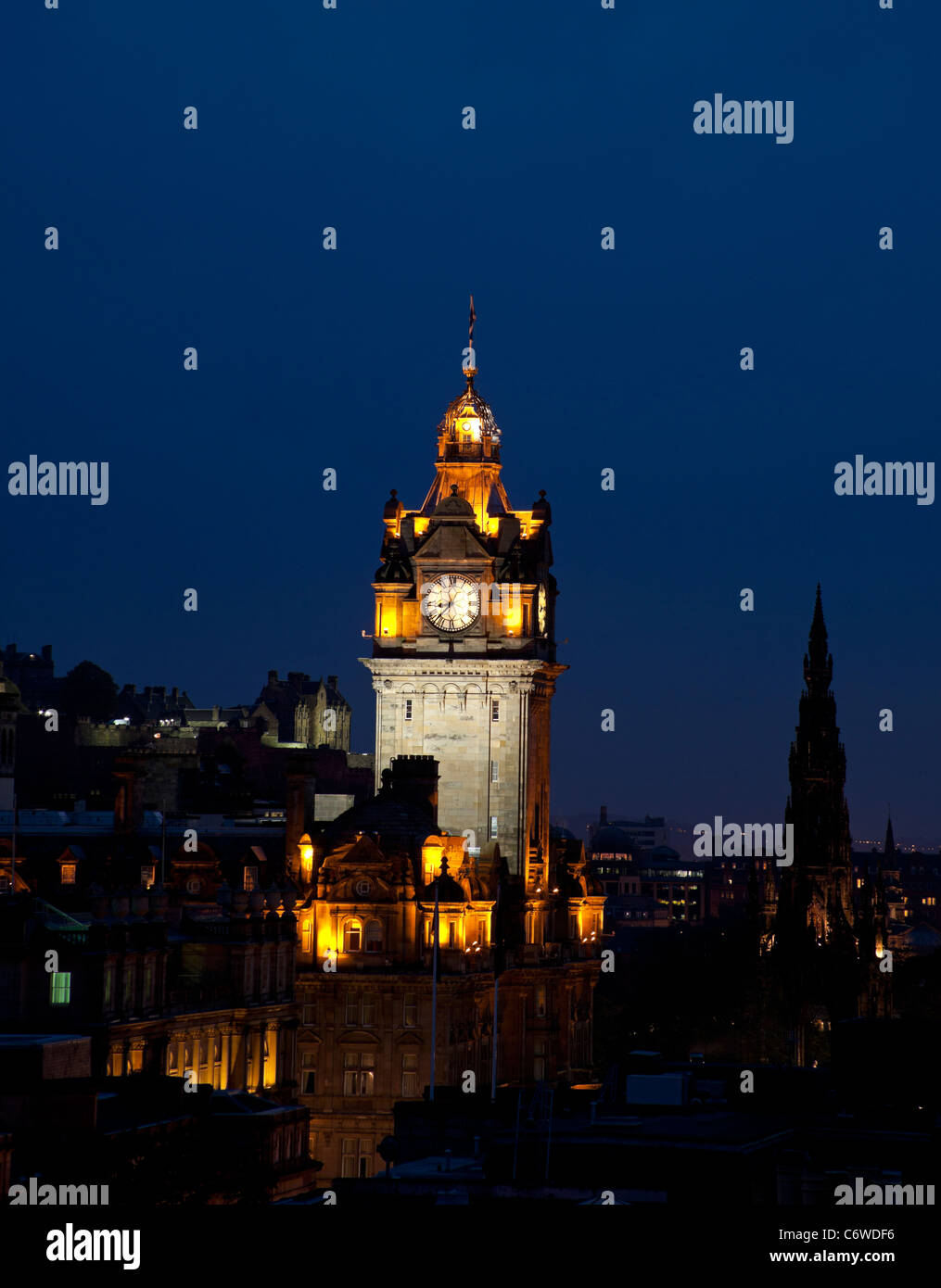 Edinburgh city centre skyline at dusk with illuminated Balmoral Hotel and the Castle Stock Photo