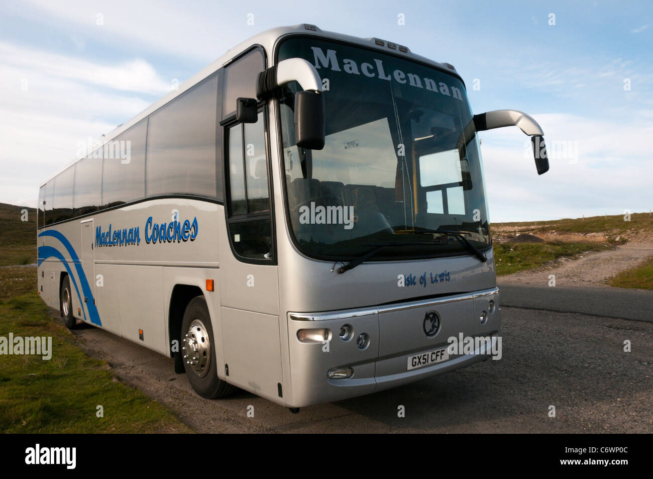 A 'MacLennan Coaches' coach at Timsgearraidh on the Isle of Lewis, Outer Hebrides, Scotland - Stock Image