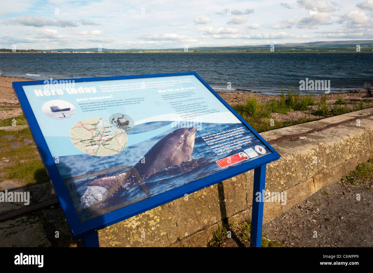 A sign gives information about the Dolphins that can be seen from Chanonry Point in the Moray Firth. - Stock Image