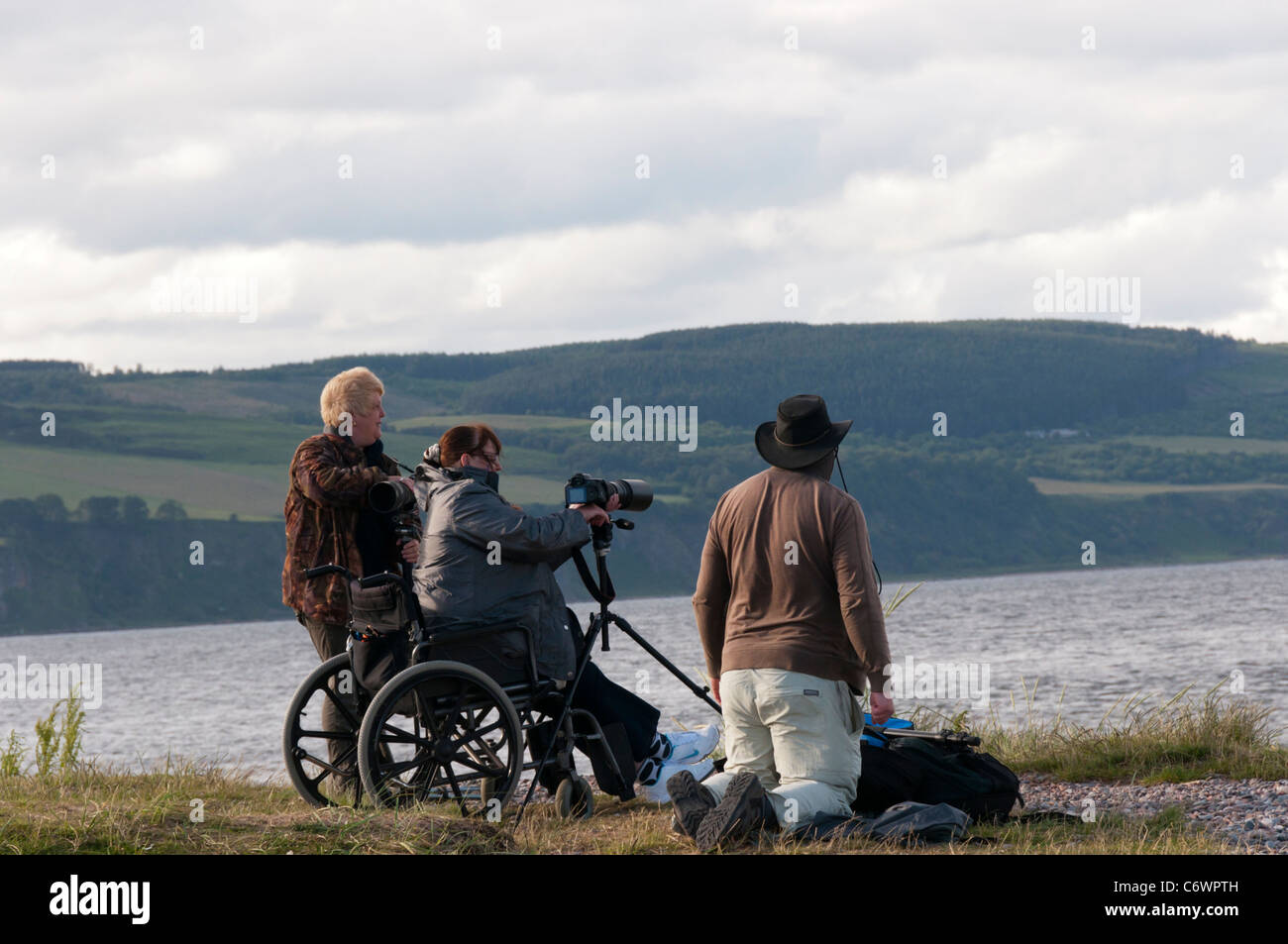 Wildlife photographers at Chanonry Point in Scotland. - Stock Image