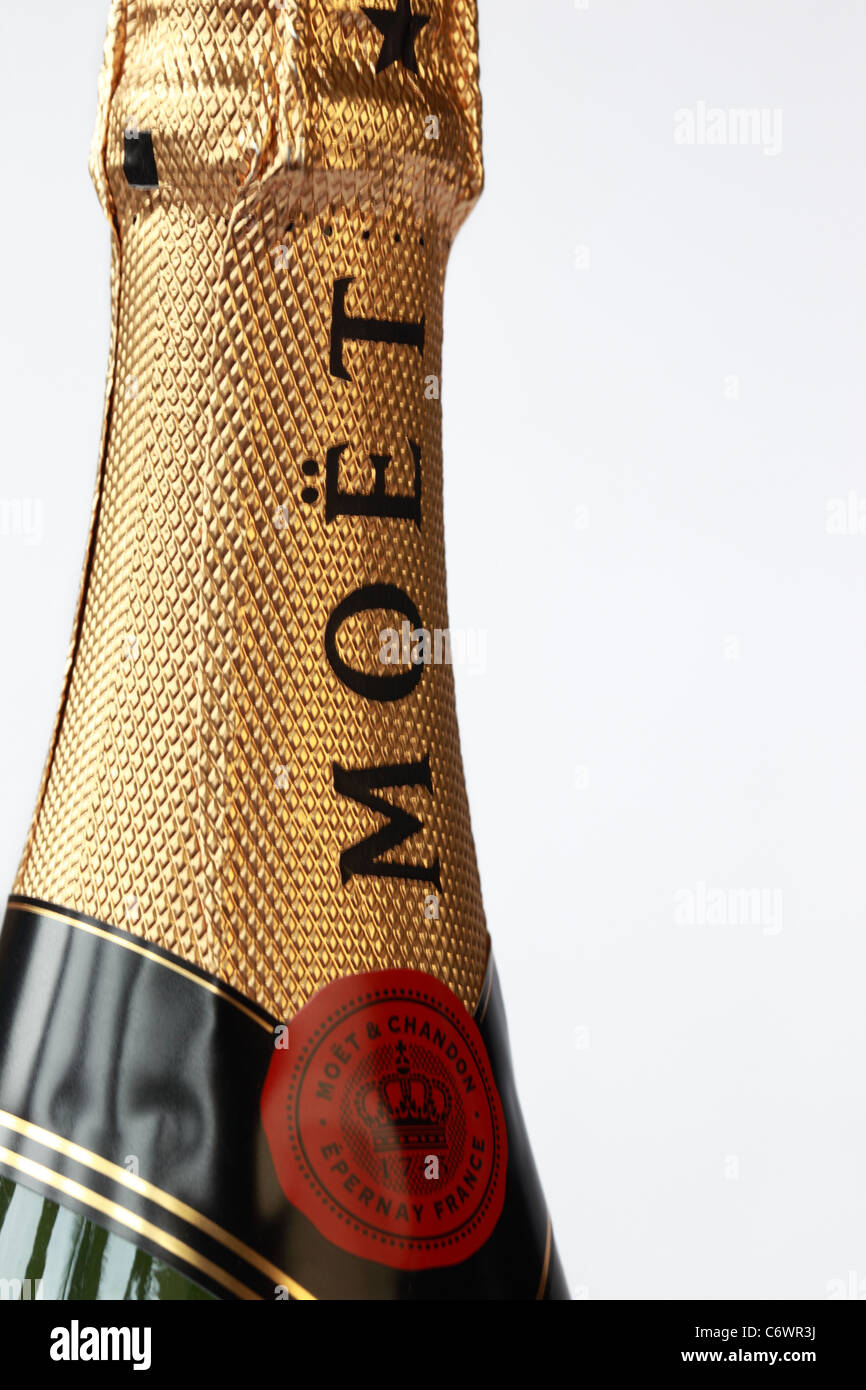 Close up of the top gold foil of an unopened bottle of Moet & Chandon Champagne - Stock Image