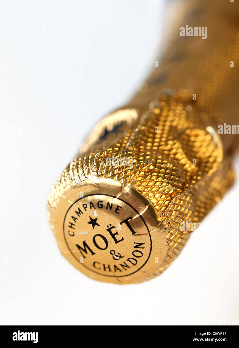 Close up of the gold foil top of an unopened bottle of Moet & Chandon, Champagne - Stock Image