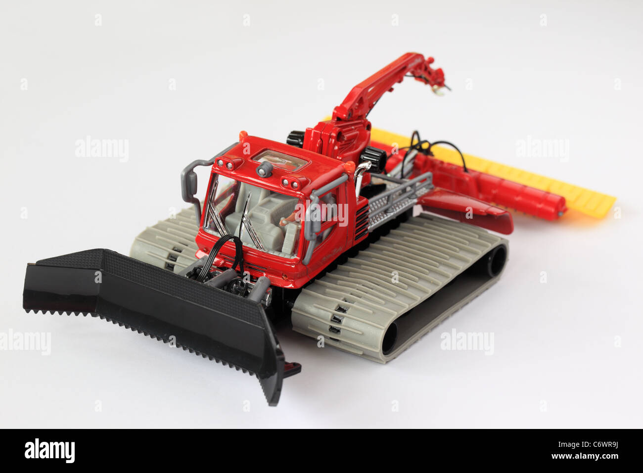 Toy Piste Basher model against a white background - Stock Image