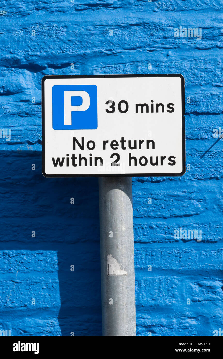 Parking restriction sign stating no return within two hours in a town in England. - Stock Image