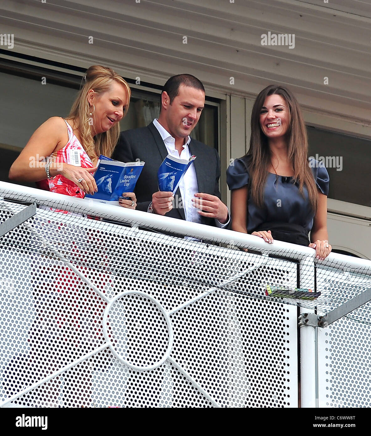 Paddy McGuiness with his fiancee Christine Martin watching the horse racing on ladies day at Chester Races Chester, - Stock Image