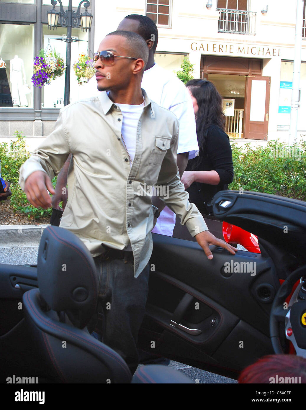 rapper t.i. in his ferrari after shopping at louis vuitton on rodeo
