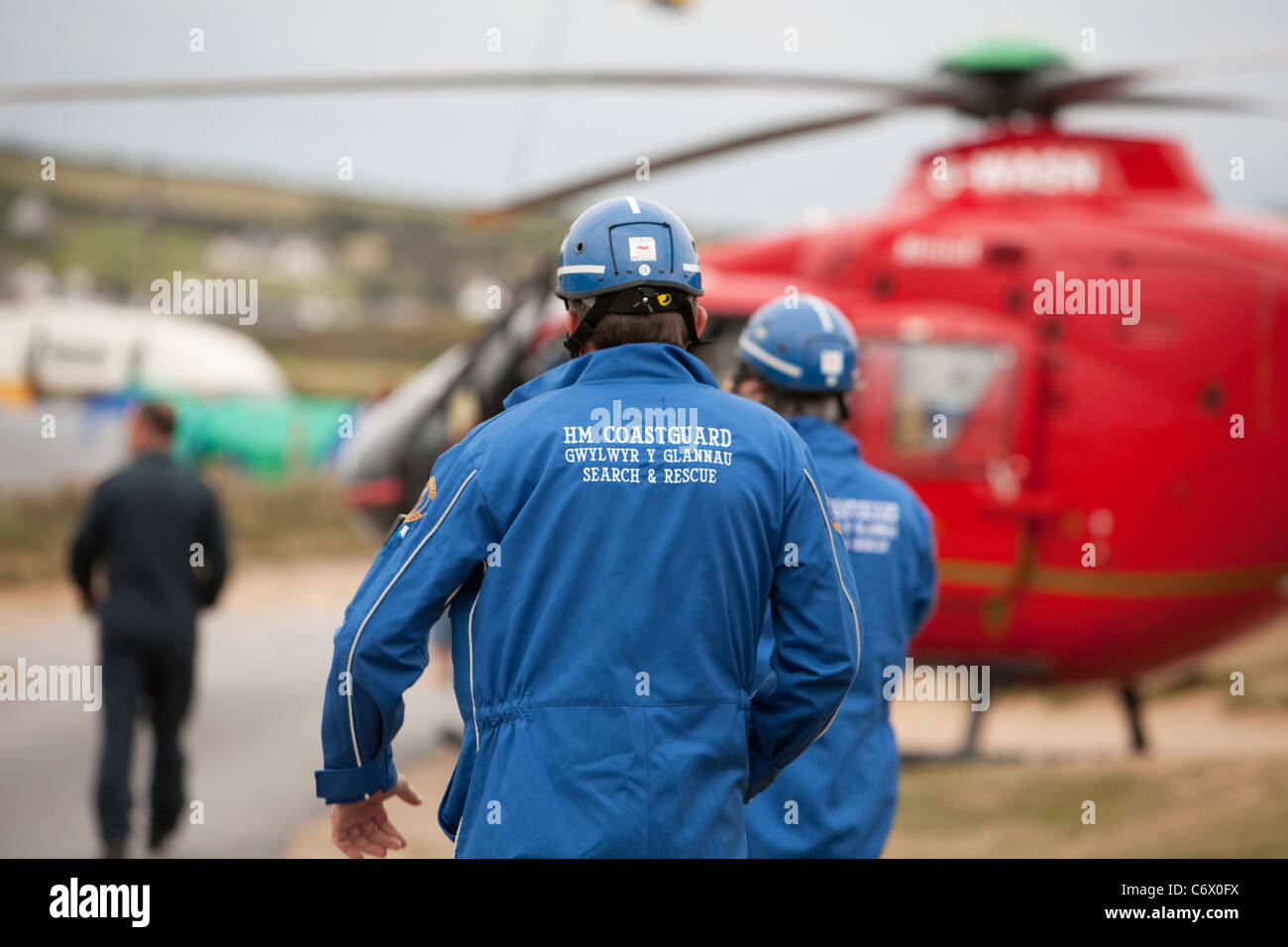 Coast Guard rescue team assist with wales air ambulance emergency rescue - Stock Image