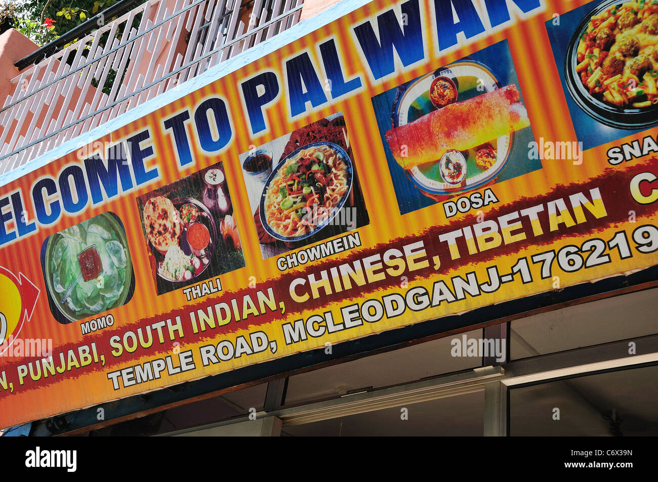 Restaurant sign board at McLeod Ganj. - Stock Image