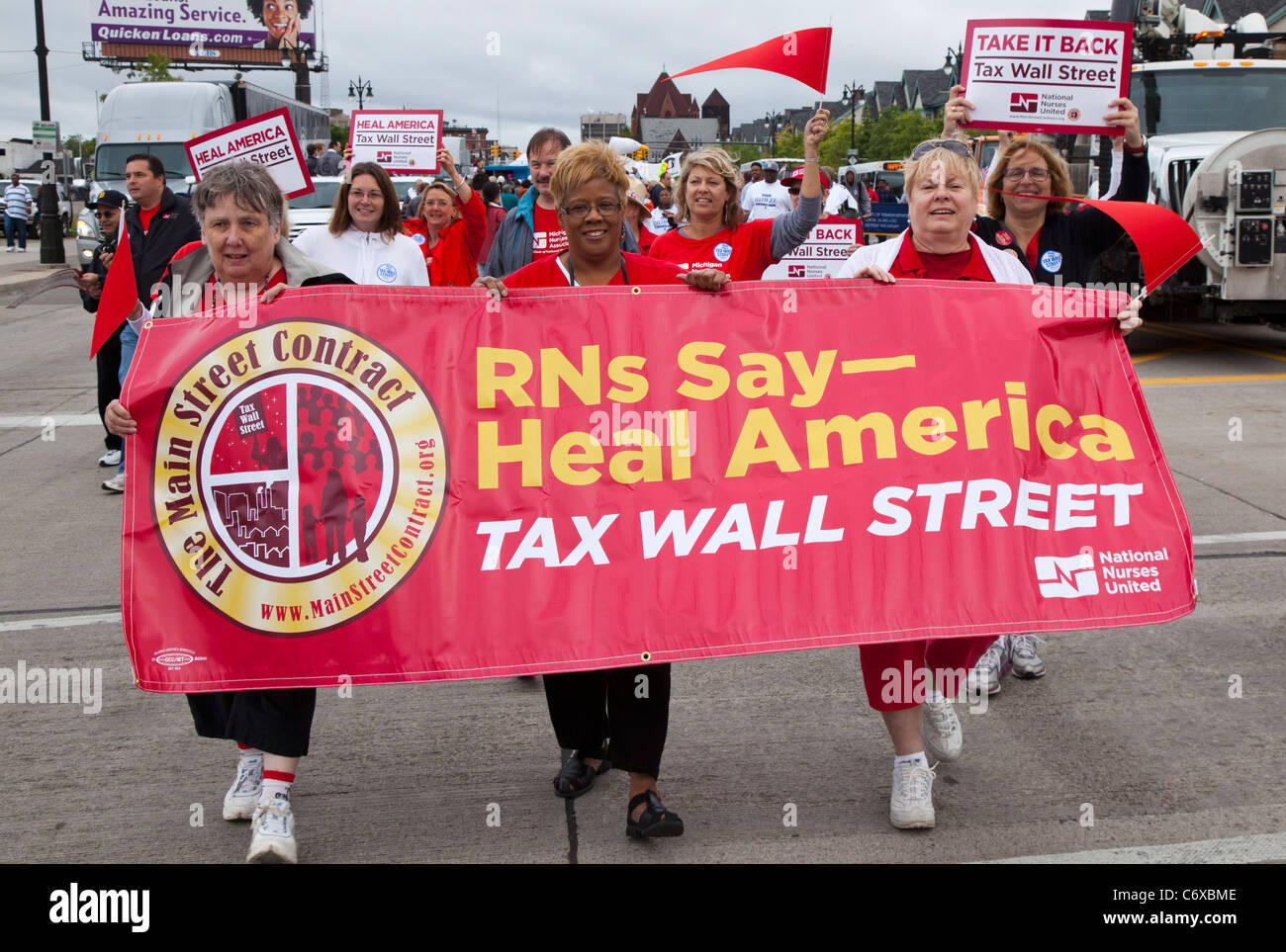 Detroit, Michigan - Members of National Nurses United march in the Labor Day parade, calling for higher taxes on - Stock Image