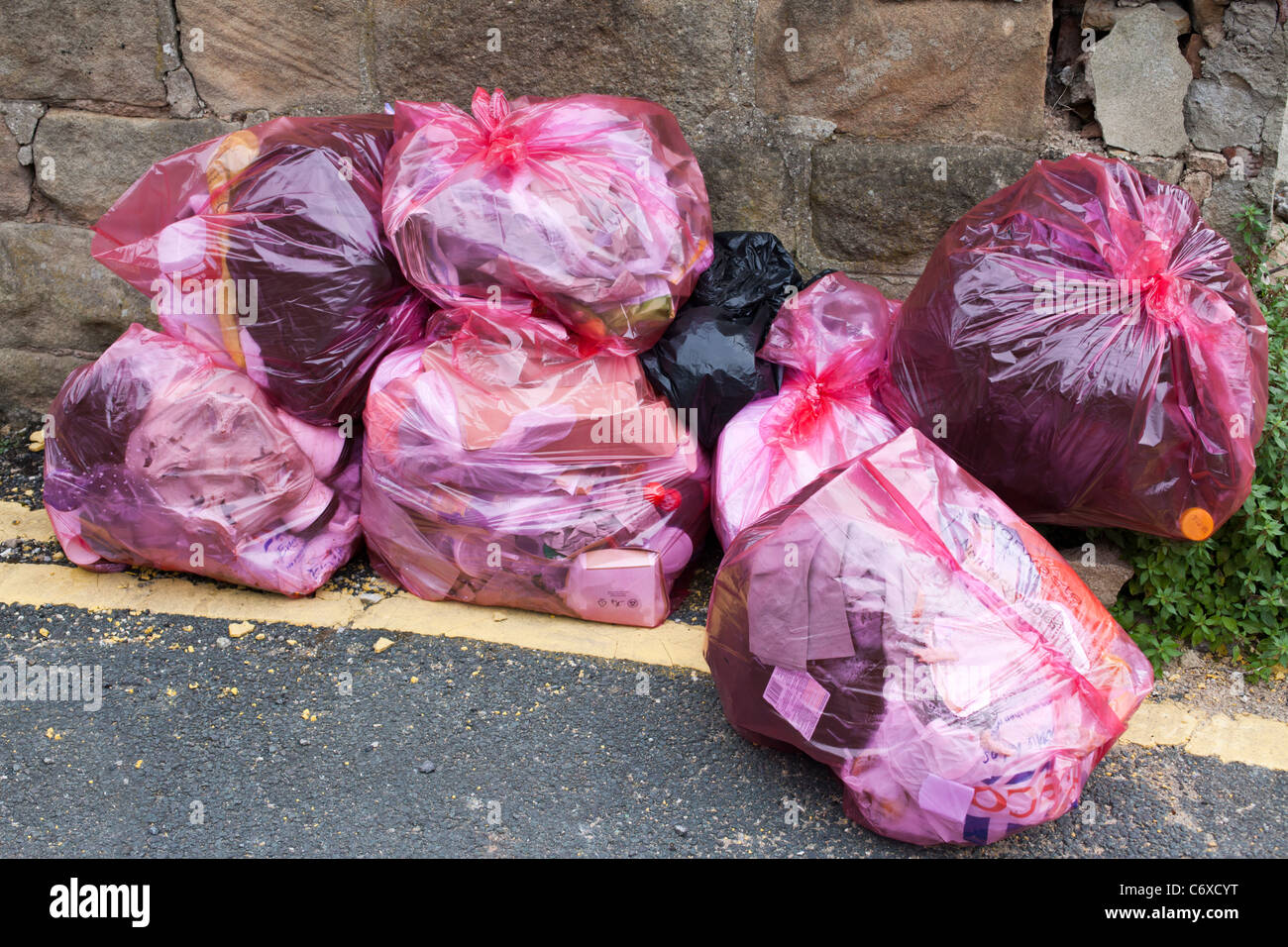 Red Rubbish Bags - Stock Image