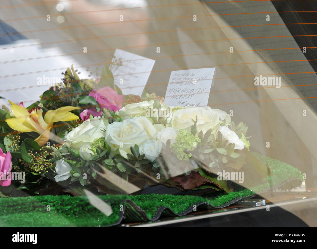 Flowers are taken to the funeral of malcolm mclaren with the words flowers are taken to the funeral of malcolm mclaren with the words never mind the bollocks written on the card london england izmirmasajfo