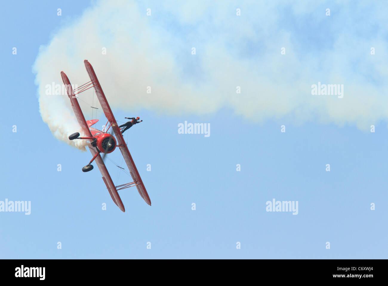 Biplane with wingwalker. - Stock Image