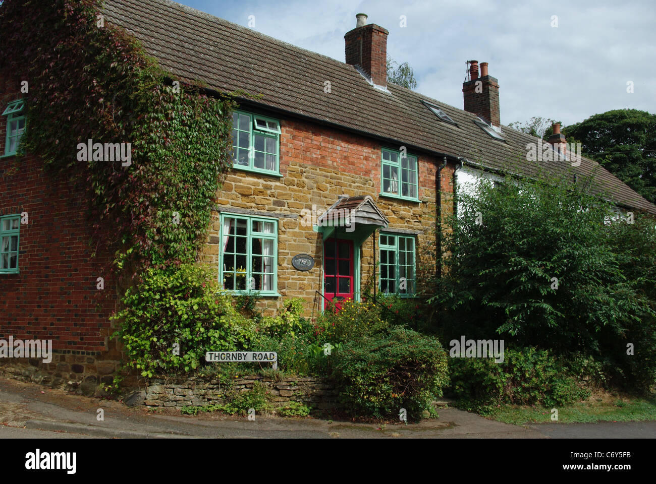 Country cottage in the village of Cold Ashby, UK - Stock Image