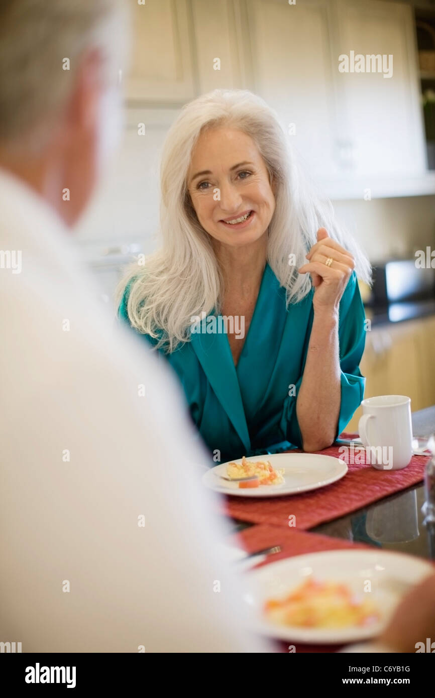 Older couple in bathrobes at breakfast - Stock Image