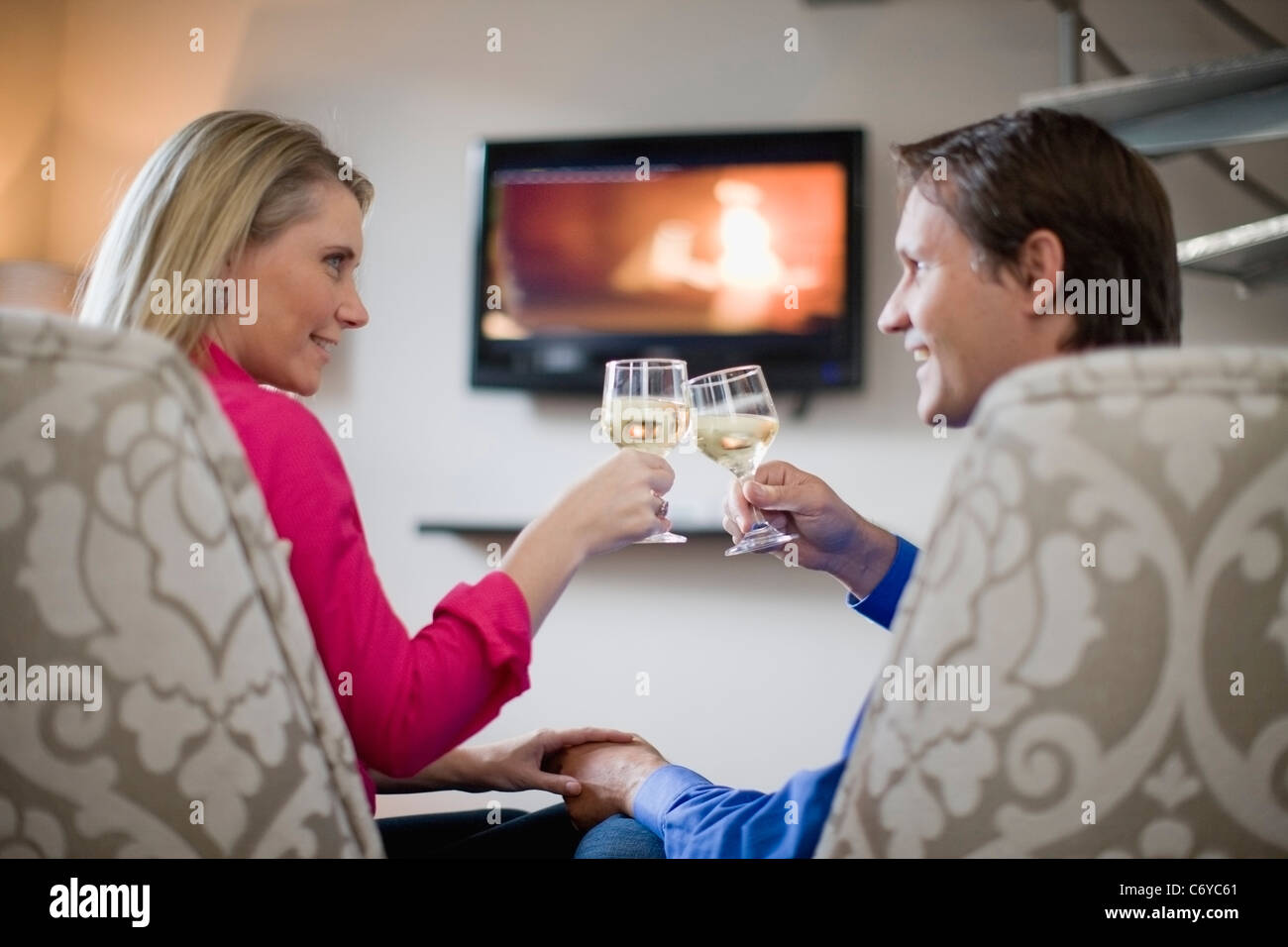 Couple toasting each other - Stock Image