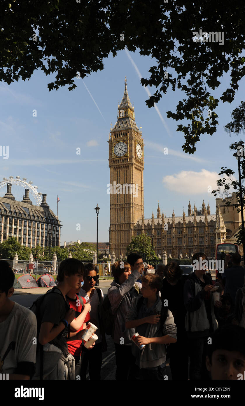 Tourists around Parliament Square in London with Big Ben in the background UK - Stock Image