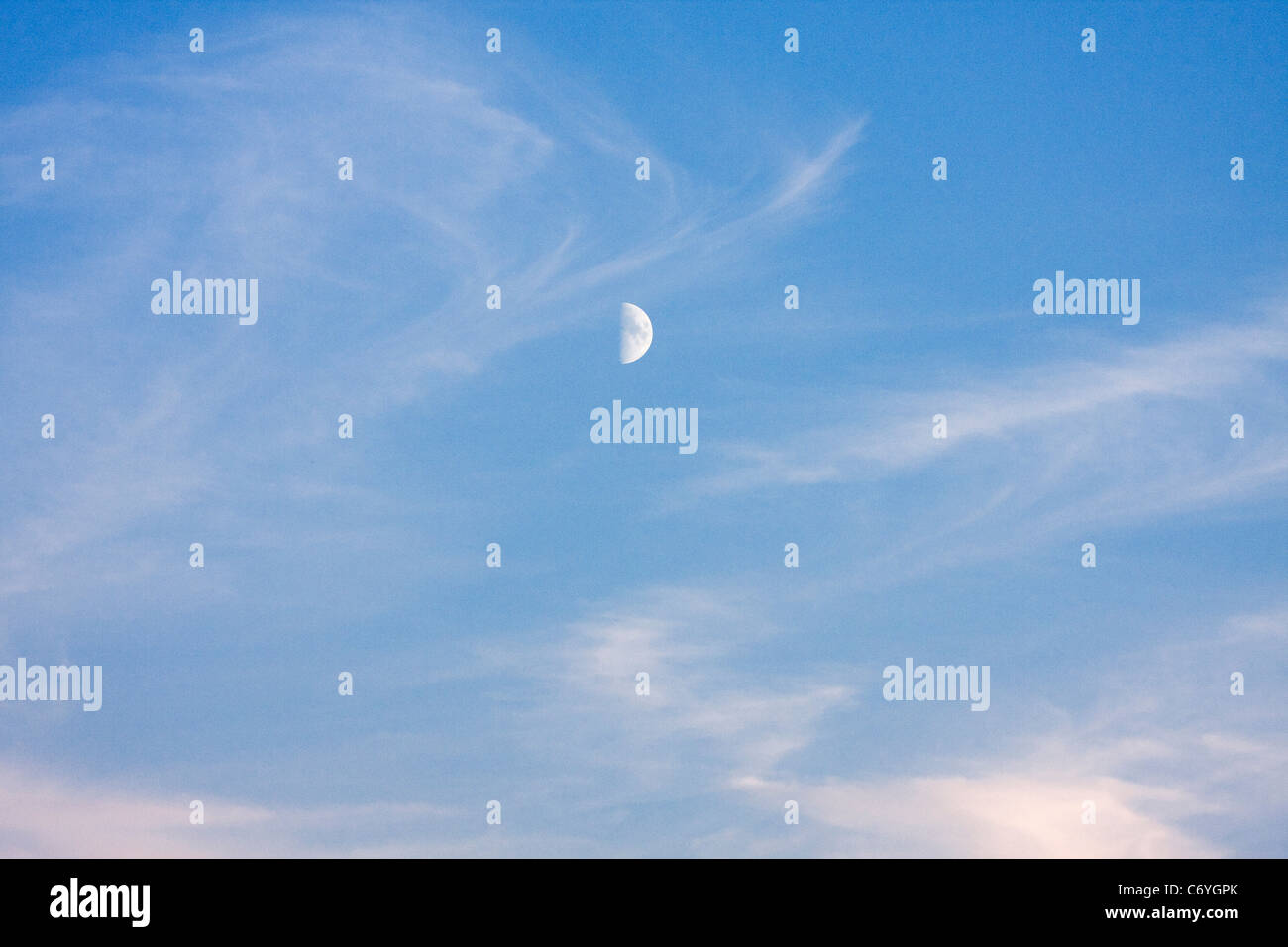 Half Moon and Wispy Clouds - Stock Image