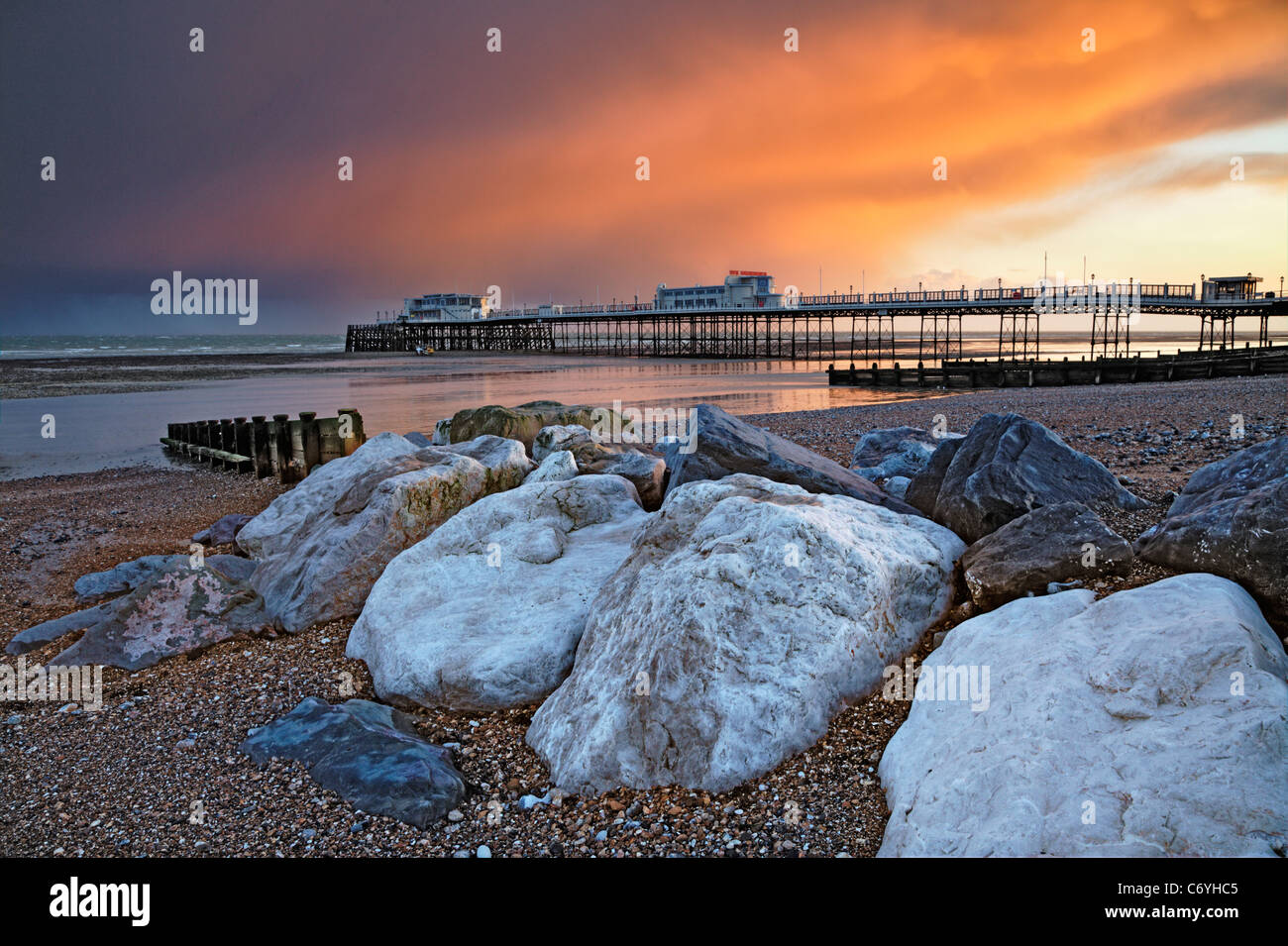 Storm clouds over Worthing Pier at Sunset, West Sussex - Stock Image