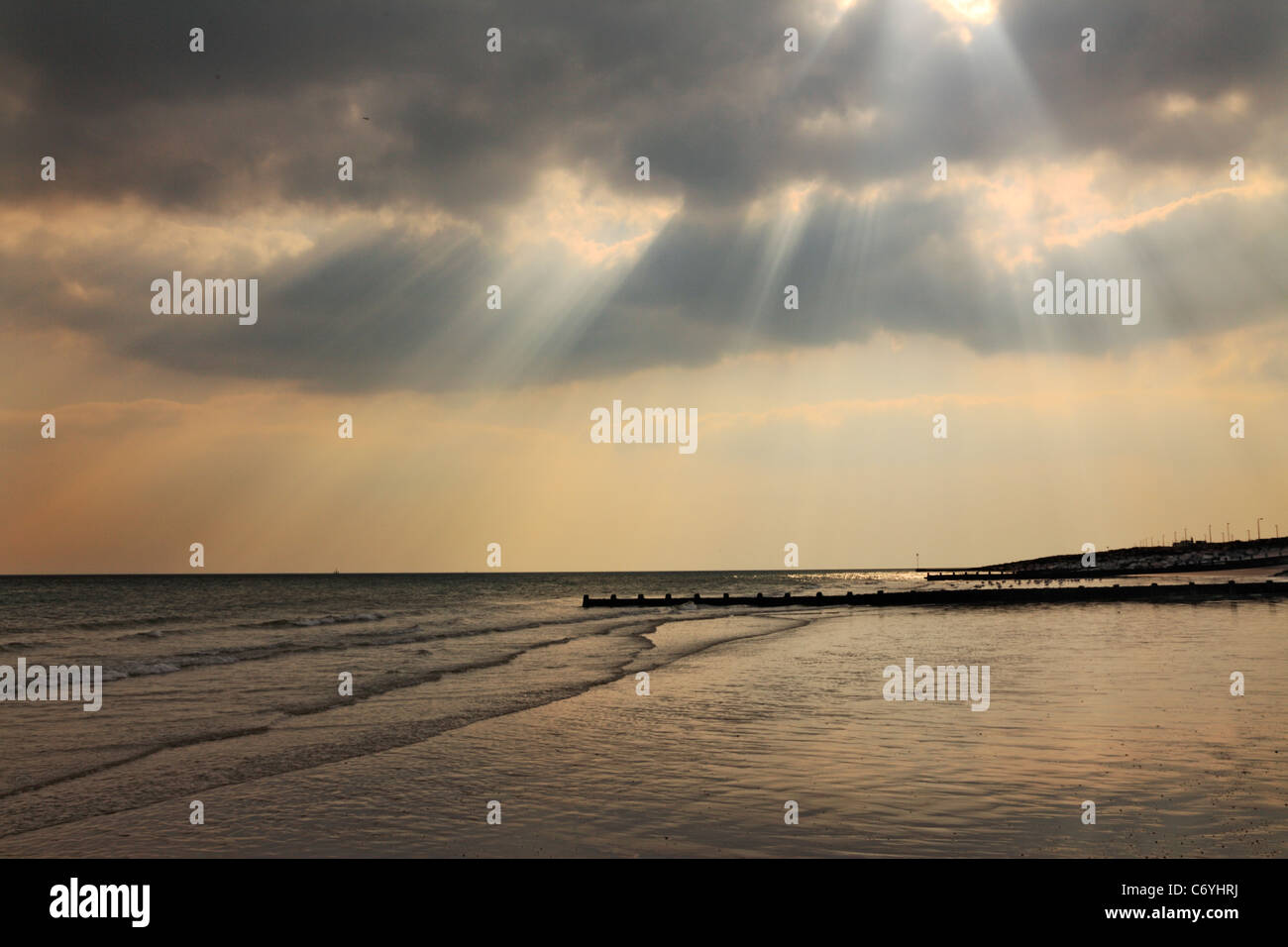 Sunrays through a stormy cloud, Worthing, West Sussex - Stock Image
