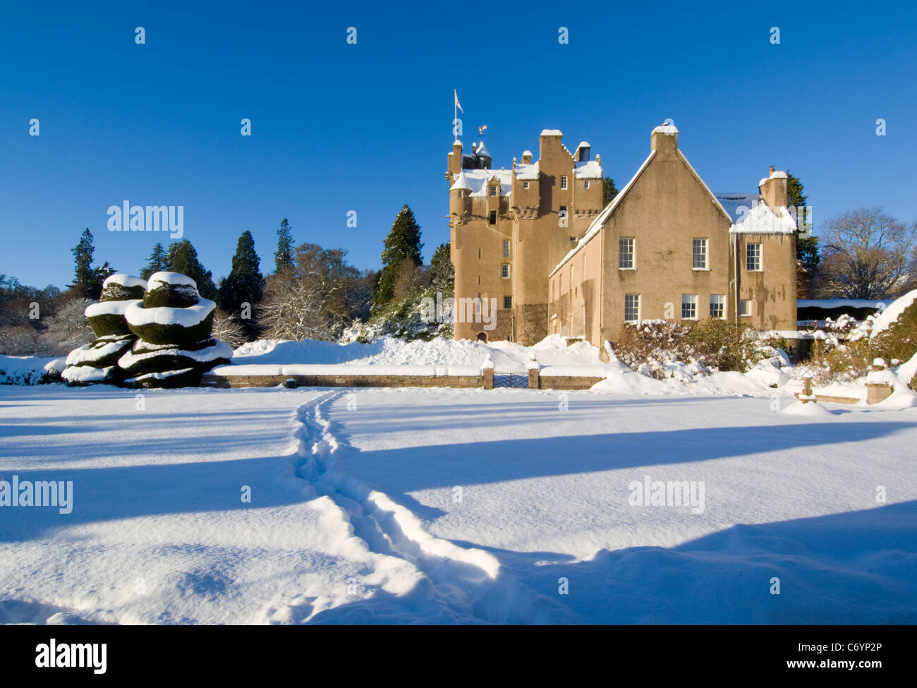 Crathes Castle and gardens in the snow, near Banchory - Stock Image