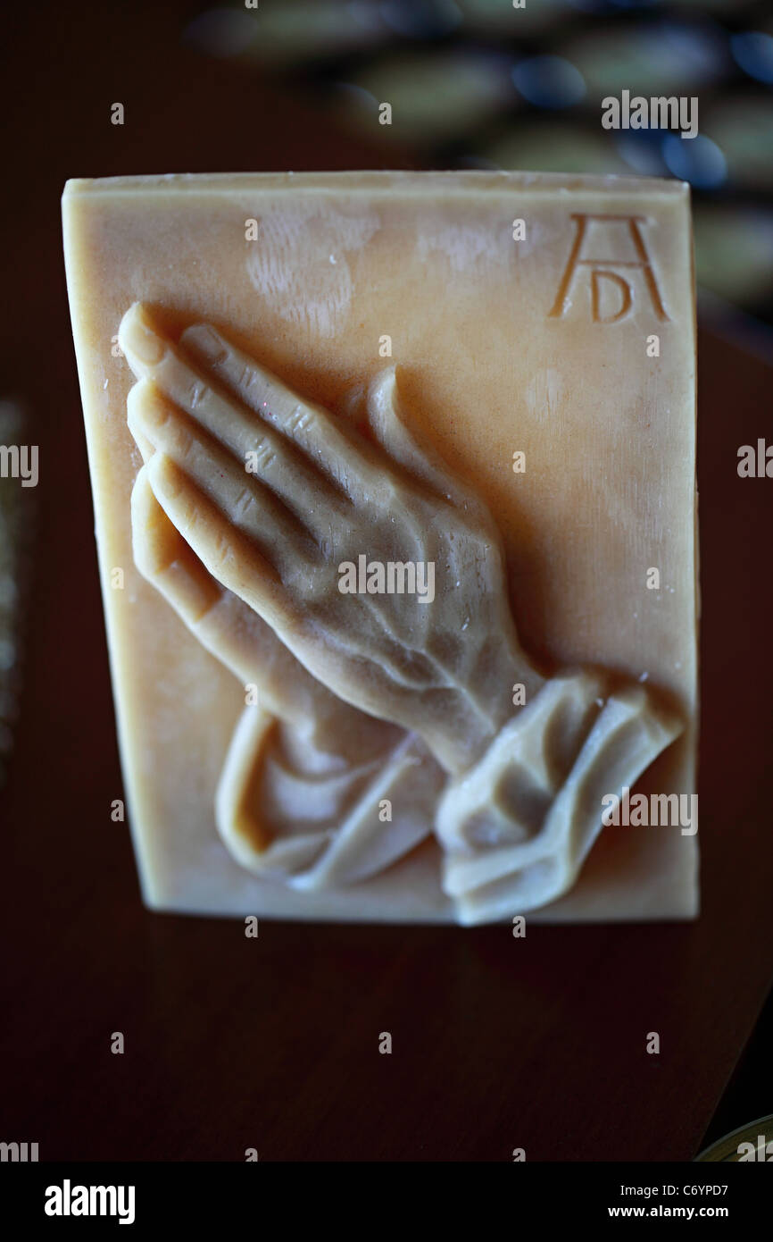 Praying hands made of beeswax Greece - Stock Image