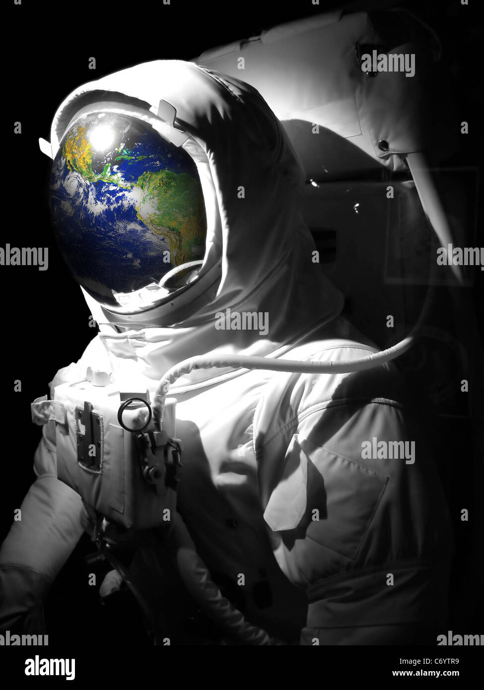 Space man astronaut suit with a reflection of the earth in ...