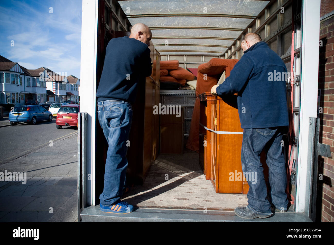 Furniture being delivered to St Luke's hospice charity shop in the London borough of Harrow - Stock Image