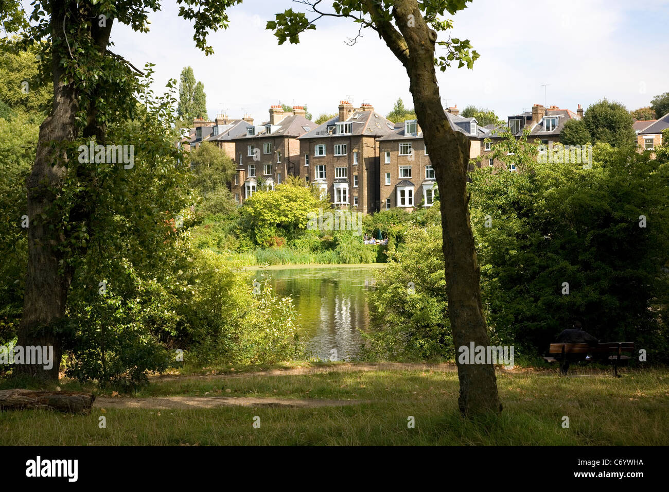 Hampstead Heath with Homes by the pond - Stock Image