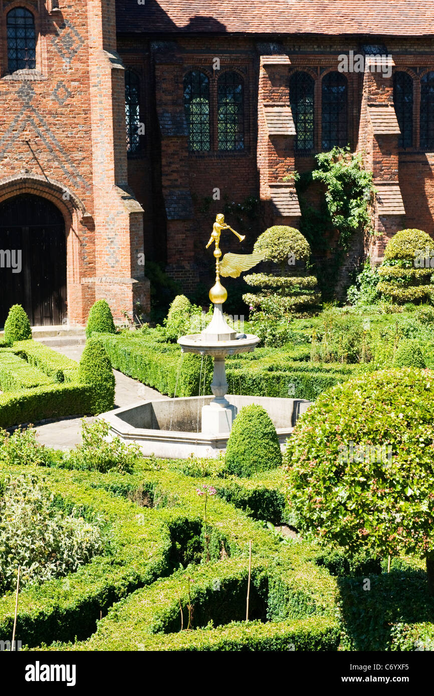Hatfield House , rear entrance & stairs to The Old Palace & Garden detail with gold statue & fountain - Stock Image