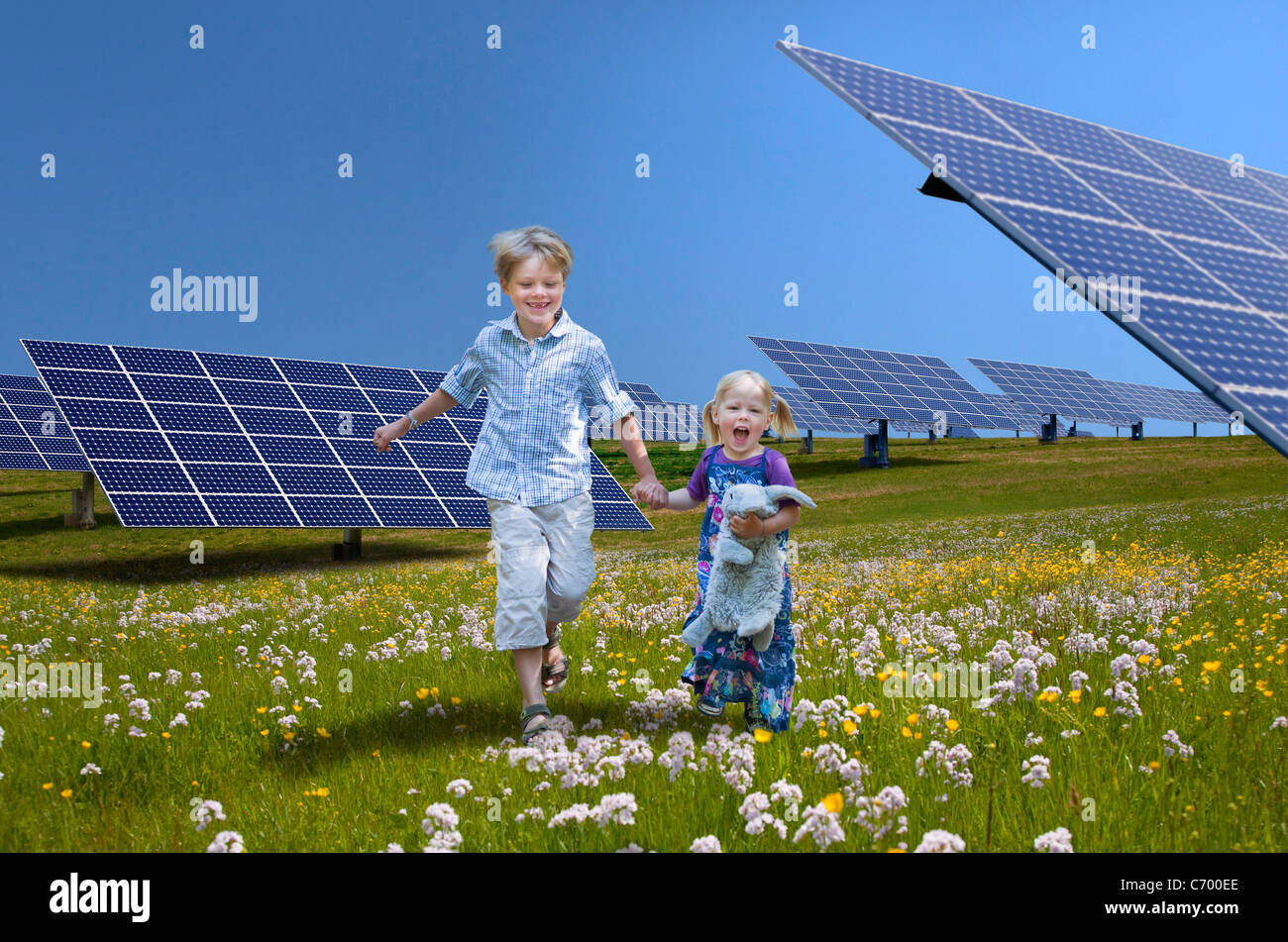 Children playing near solar panels stock photo 38723734 for How to make a solar panel for kids