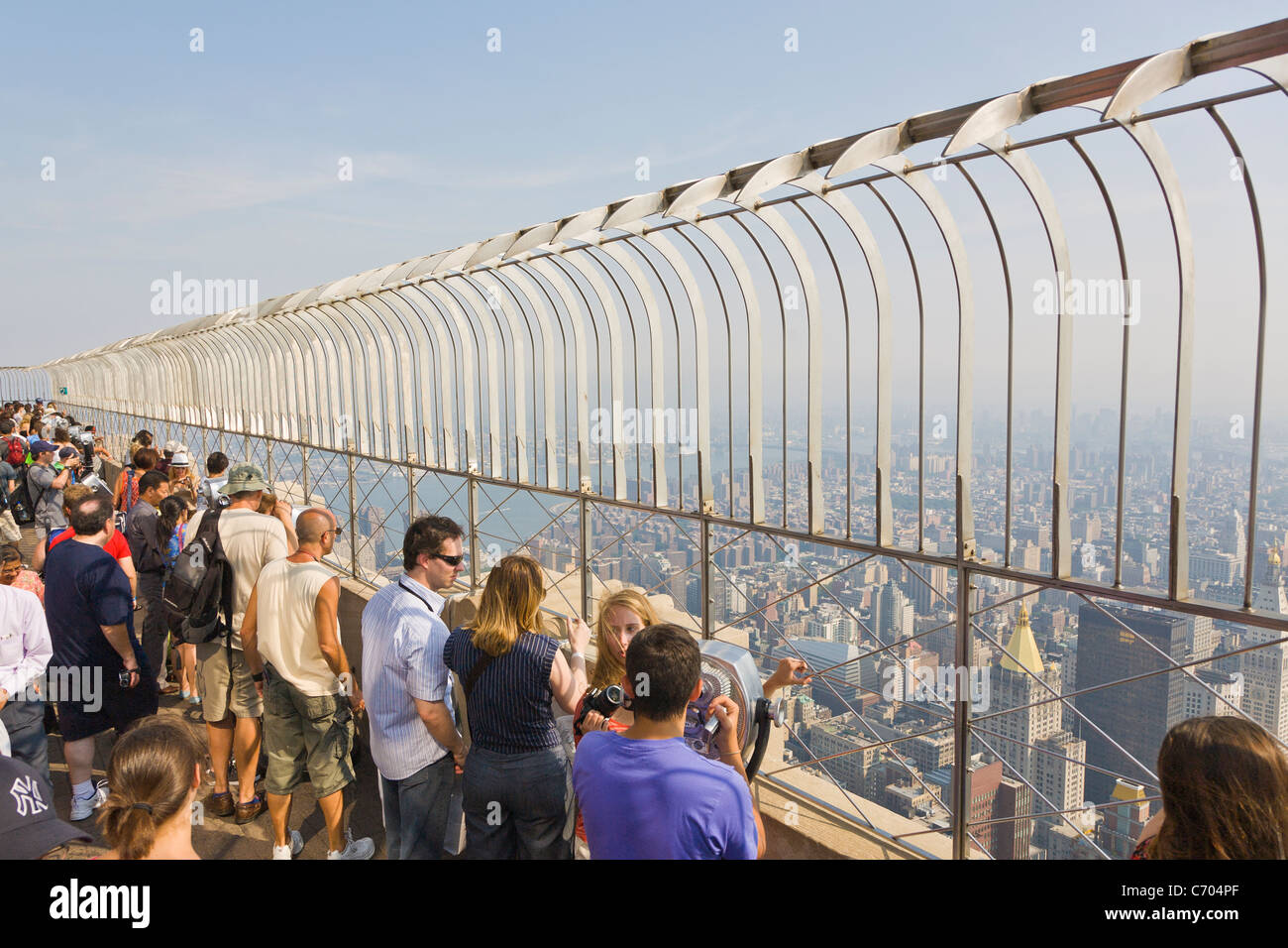 tourists on observation deck of empire state building in new york
