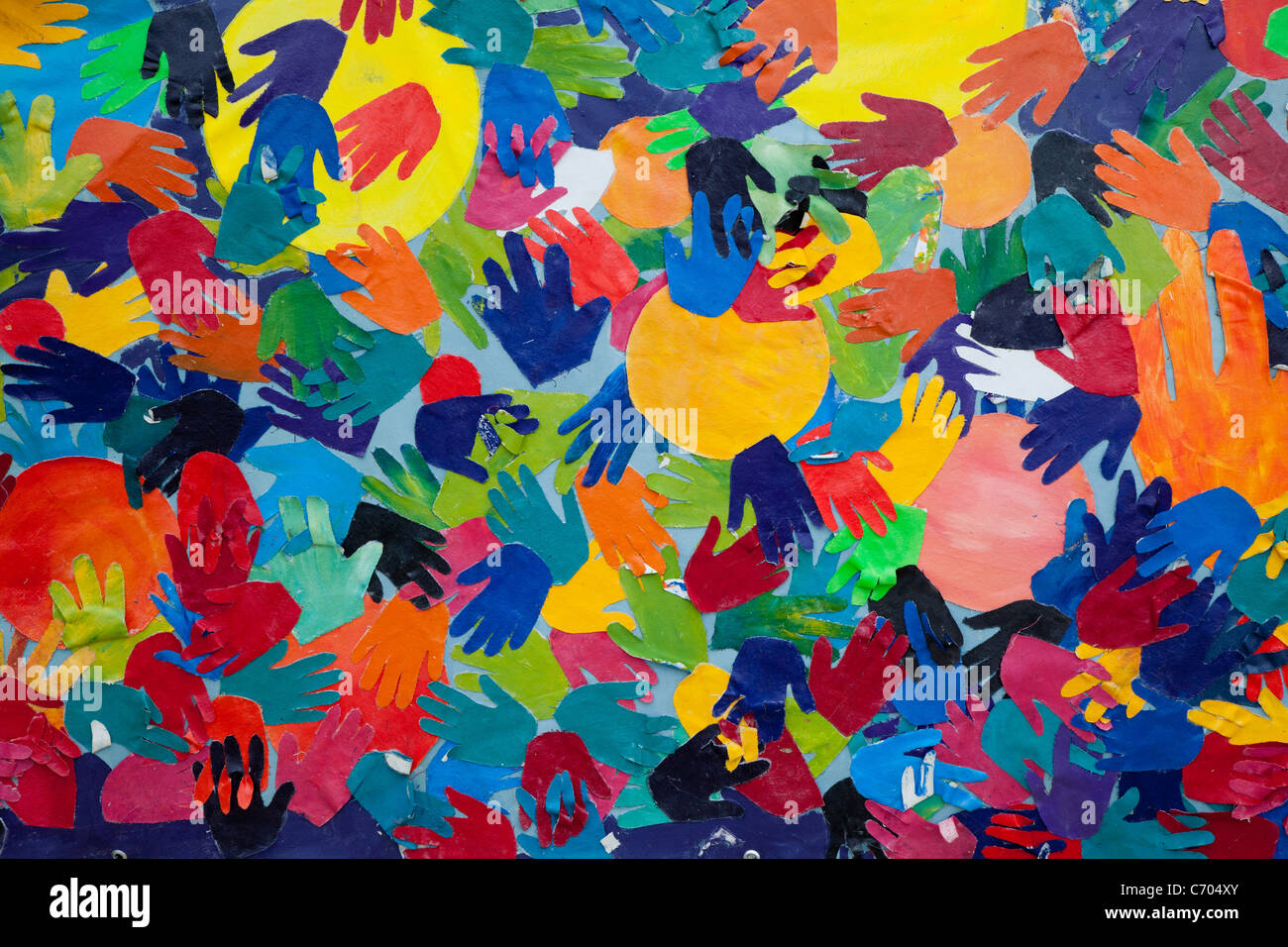 Detroit, Michigan - Artwork showing colorful hands displayed along the Detroit River Walk. - Stock Image