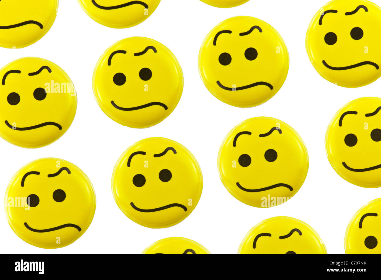 upset emoticons on a white background - Stock Image