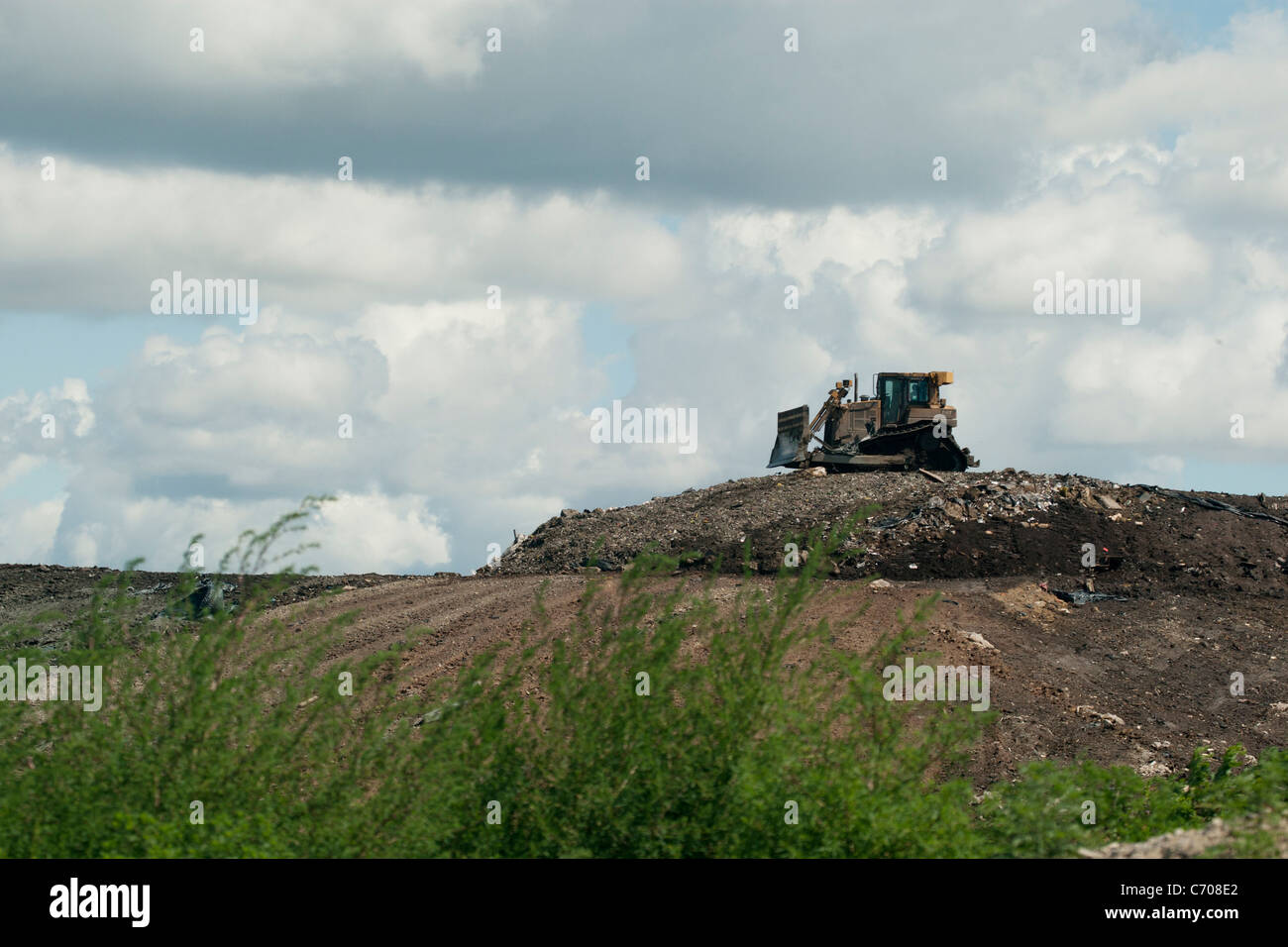 bulldozer on landfill - Stock Image
