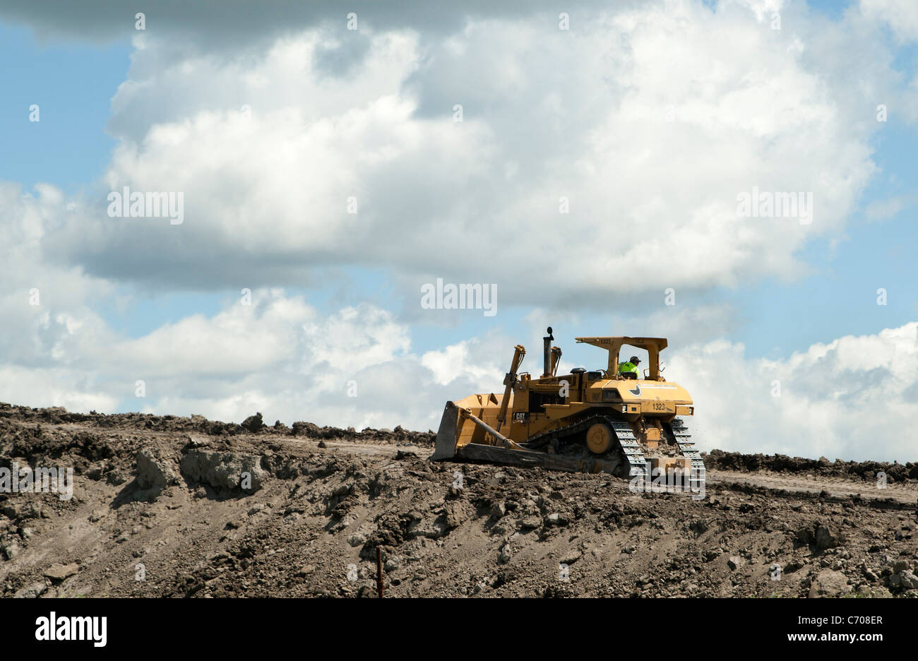 Earth moving equipment on landfill - Stock Image