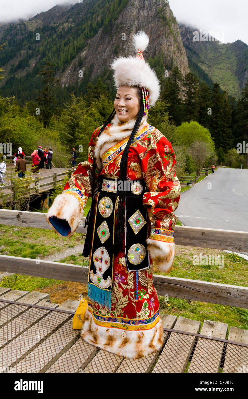 Chinese tourist / tourists wearing Tibetan national costume at Jiuzhaigou National Scenic Area / park Sichuan Province China.  sc 1 st  Alamy & Chinese tourist / tourists wearing Tibetan national costume at Stock ...