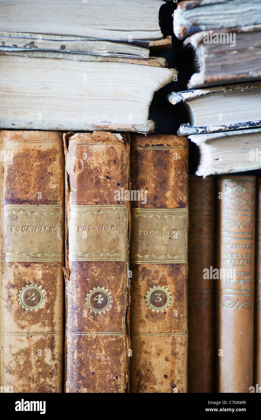 Close up of old leather bound books - Stock Image