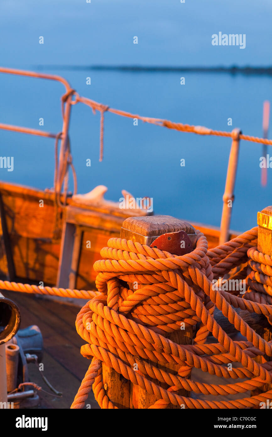 Close up of coiled rope on boat - Stock Image