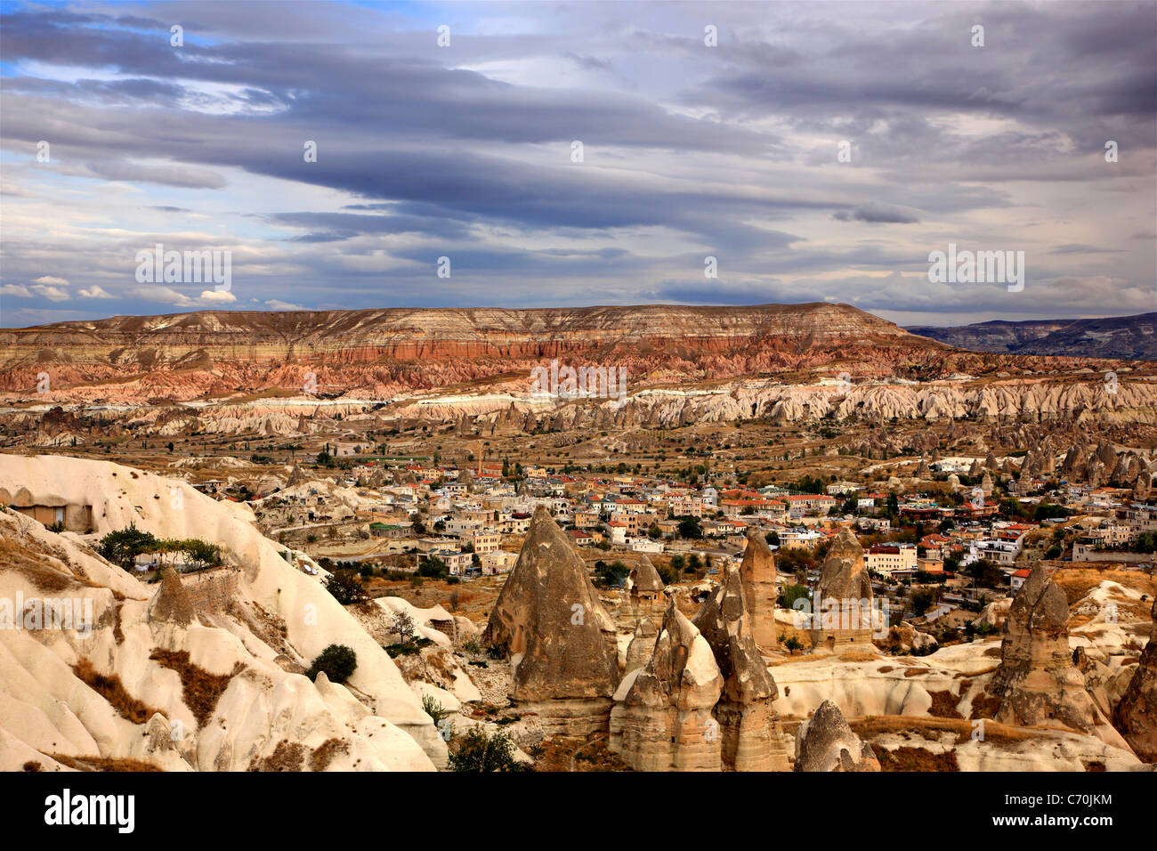 Picturesque Goreme village surrounded by the spectacular landscape of Cappadocia on the edge of Pigeon valley, Nevsehir, - Stock Image