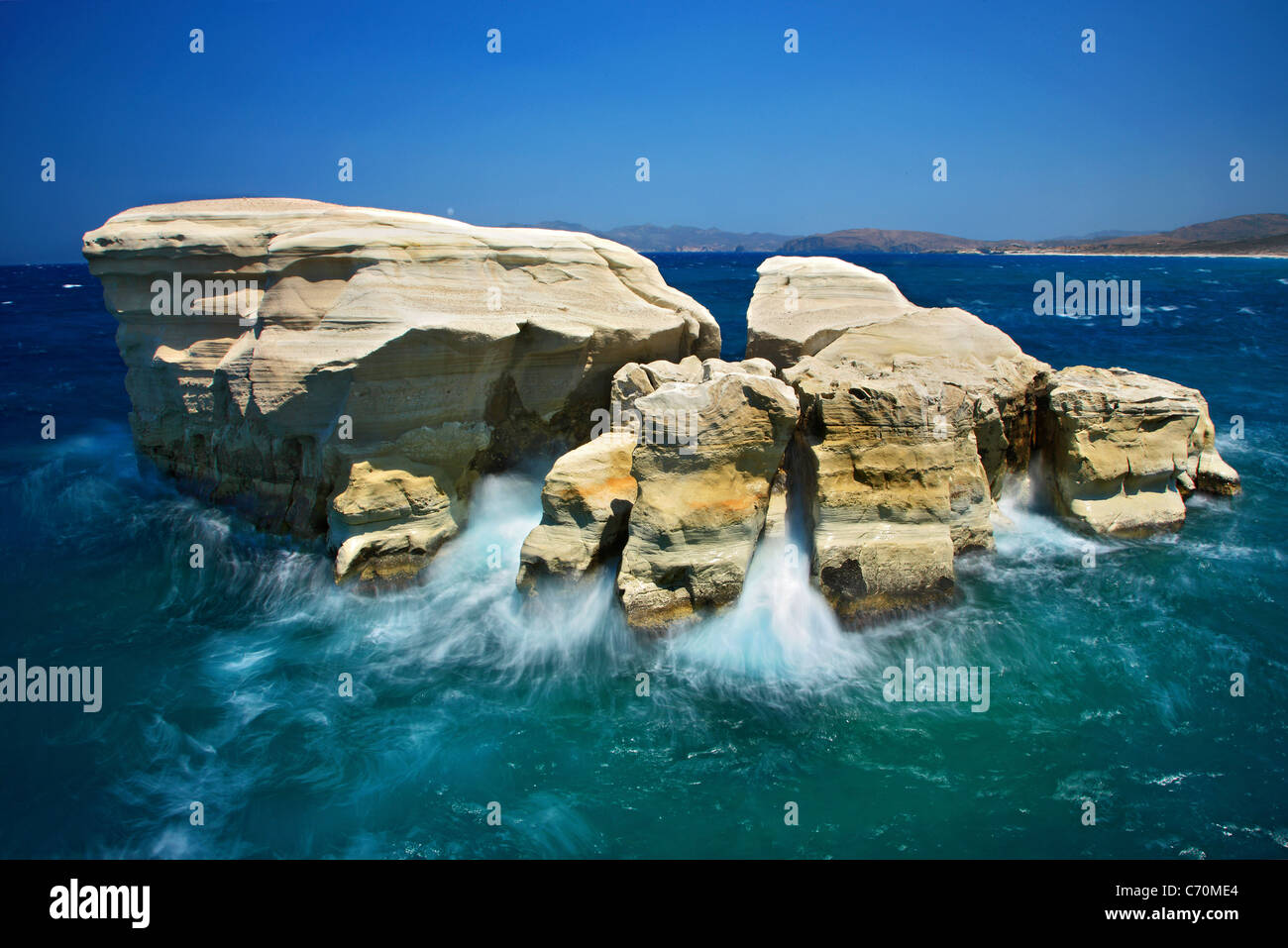 Long exposure shot of some rocks in Sarakiniko beach, just to give the impression of the 'birth of an island'. - Stock Image