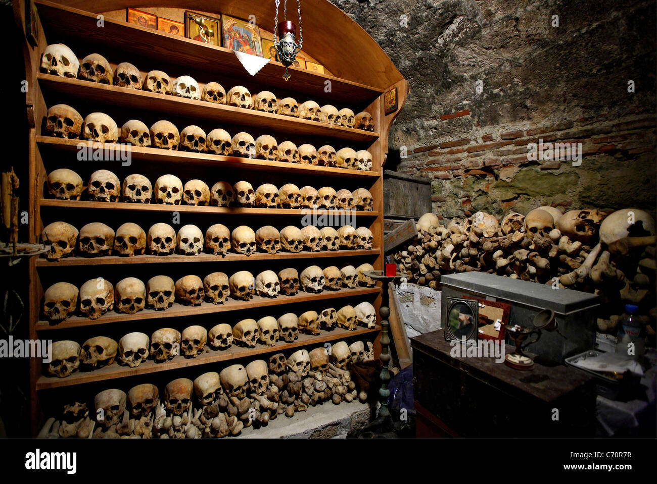 The ossuary with skulls of dead monks in the Great Meteoron monastery, Meteora, Greece - Stock Image