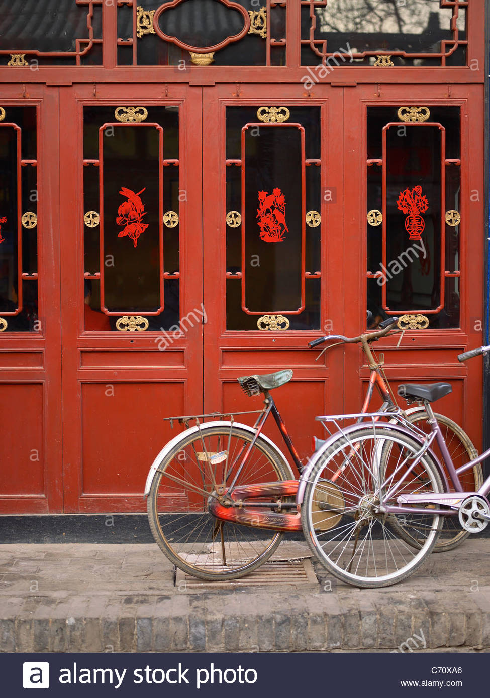 Bikes parked in front of Chinese cafe - Stock Image
