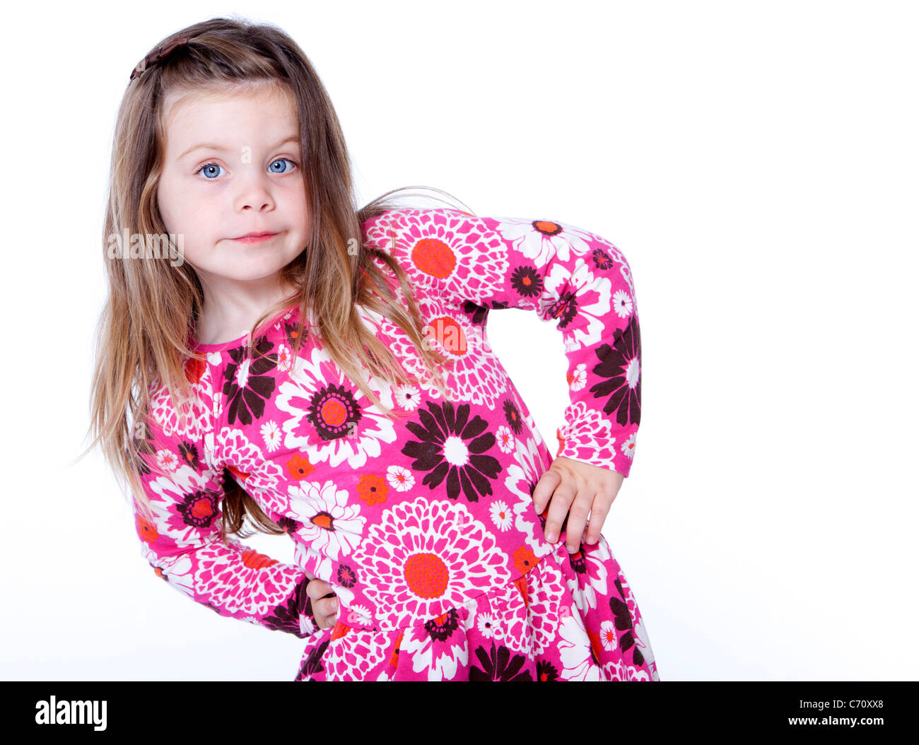 Young girl with hands on hips isolated on white - Stock Image