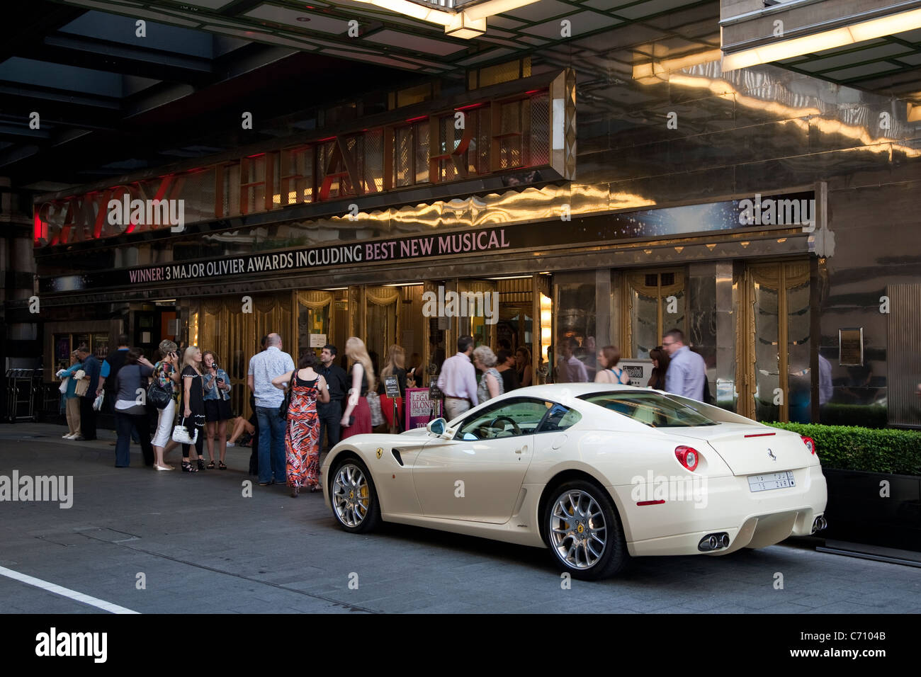 Savoy Theatre with a Ferrari Car; London, England, UK - Stock Image