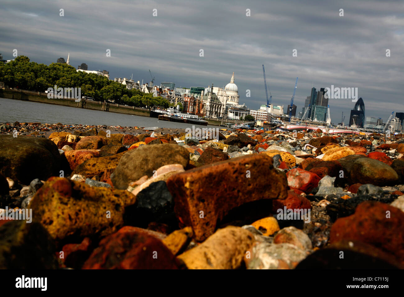 View from the foreshore of the River Thames at South Bank looking towards St Paul's Cathedral and City of London, - Stock Image