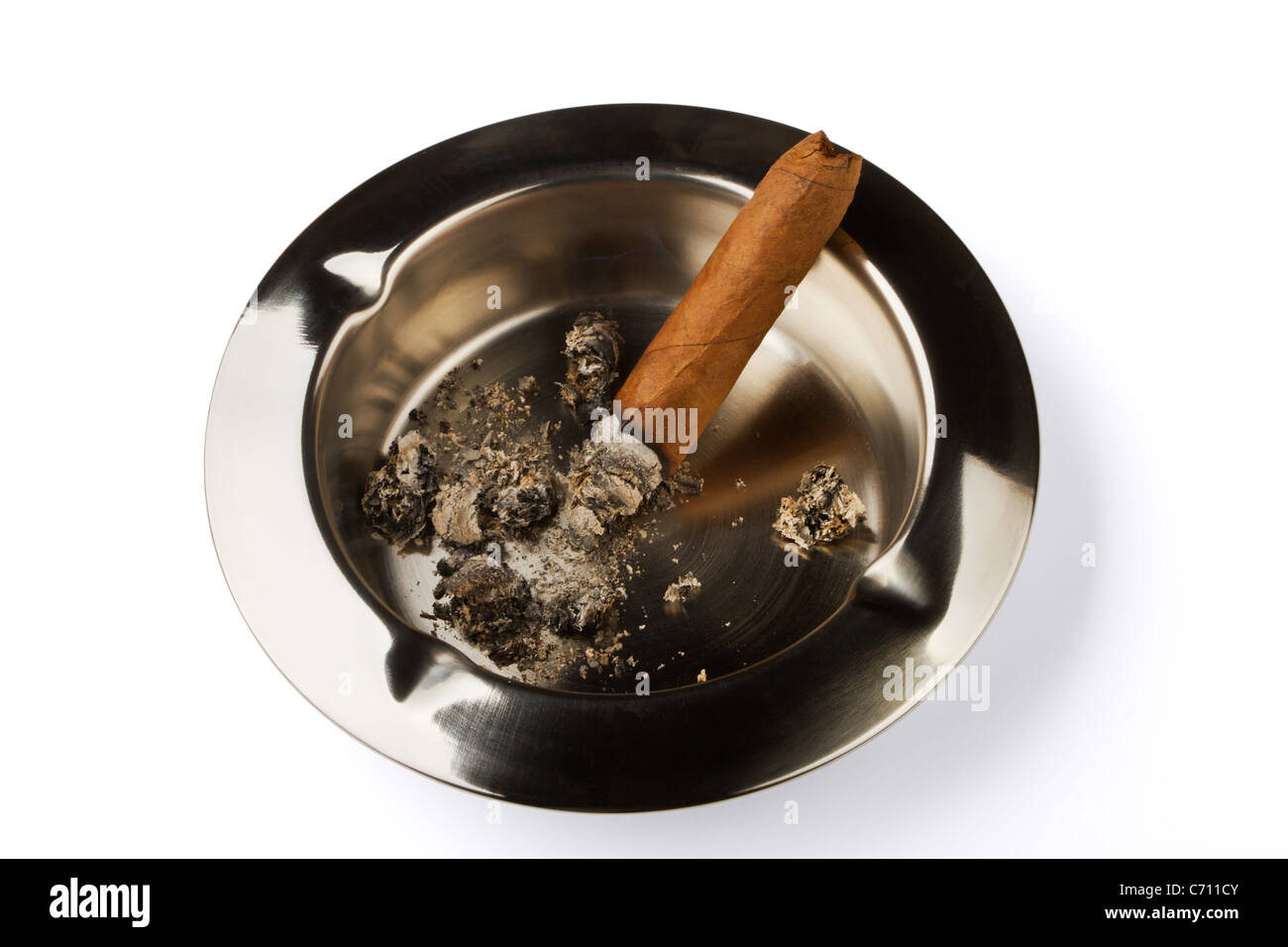 Ashtray with a decaying cigar isolated on a white background - Stock Image