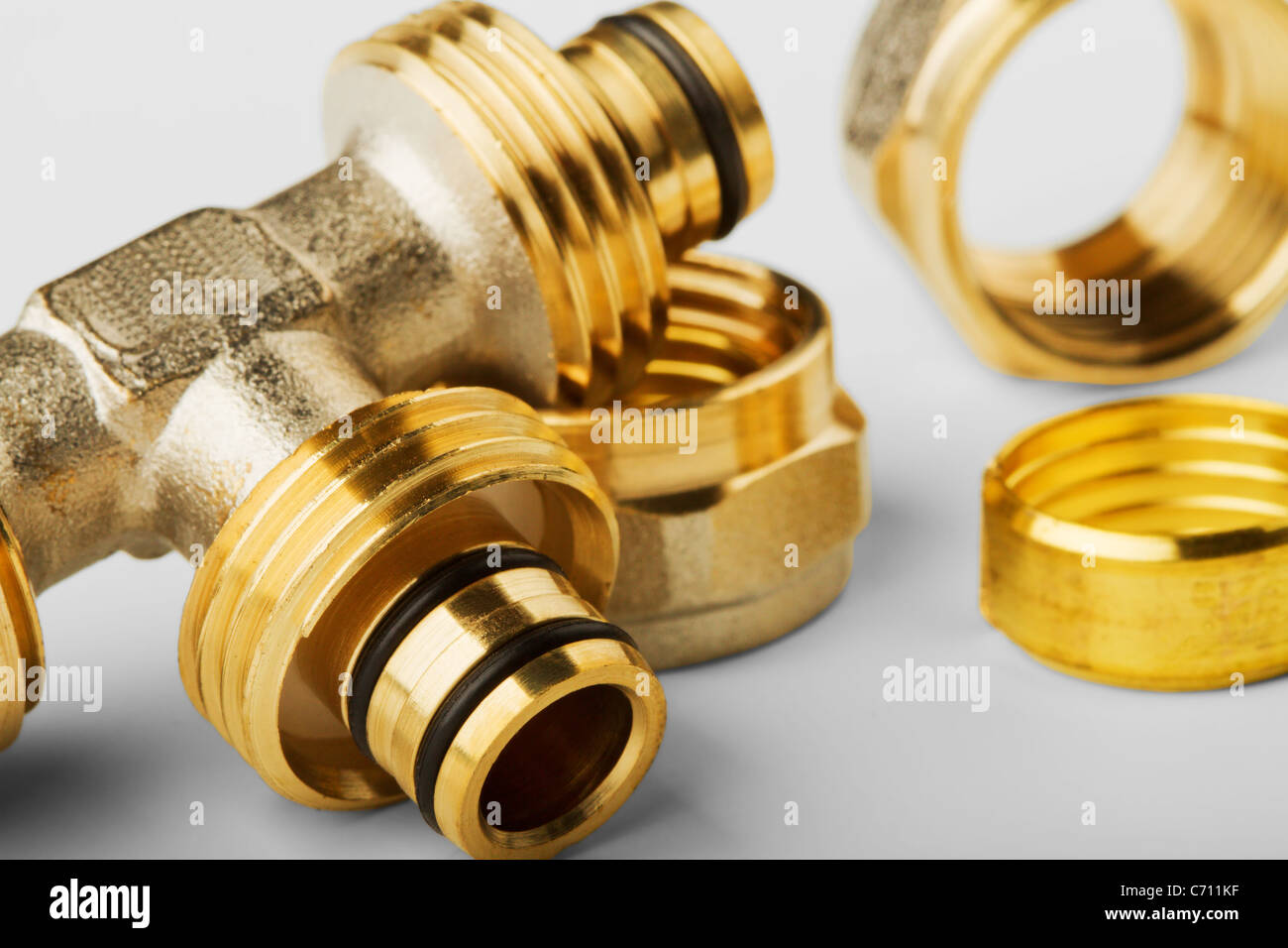 pipe fittings isolated on a white background - Stock Image