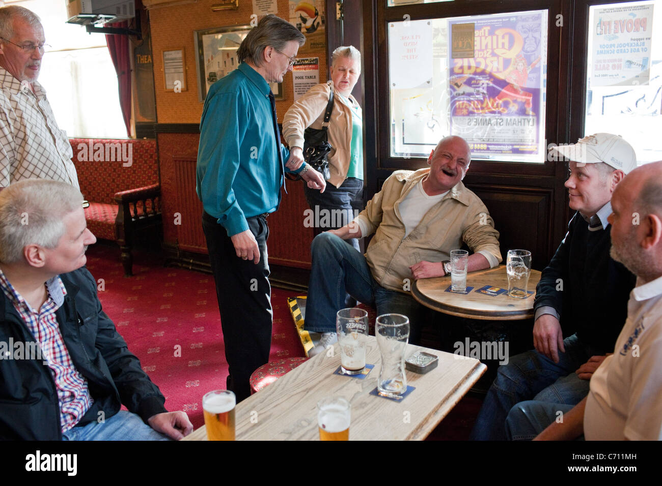 A group of people in a local pub on a Sunday afternoon in Blackpool, England. - Stock Image