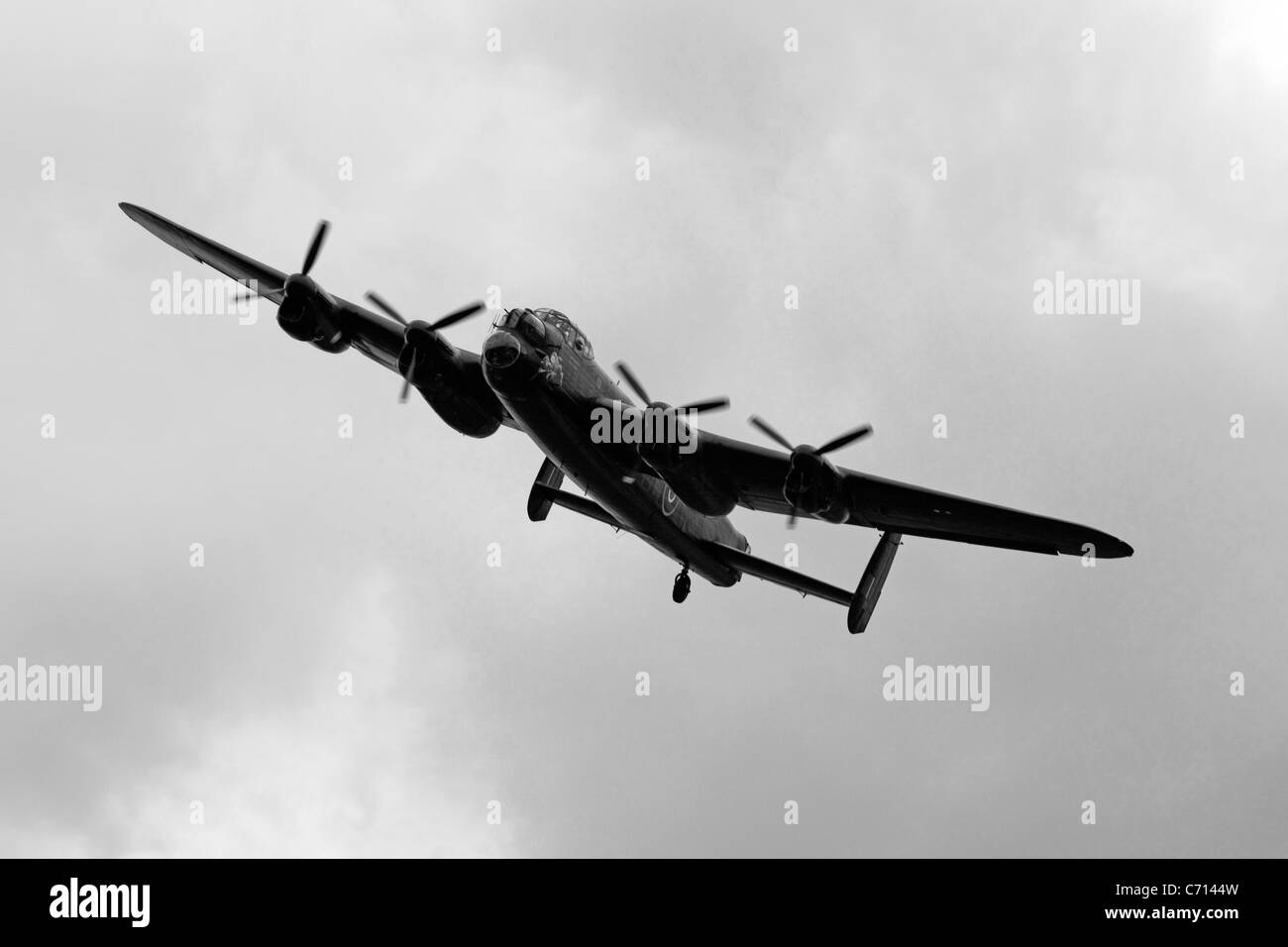 B/W WW2 British RAF Avro Lancaster Bomber Plane on a pass over an airfield during an Airshow Stock Photo