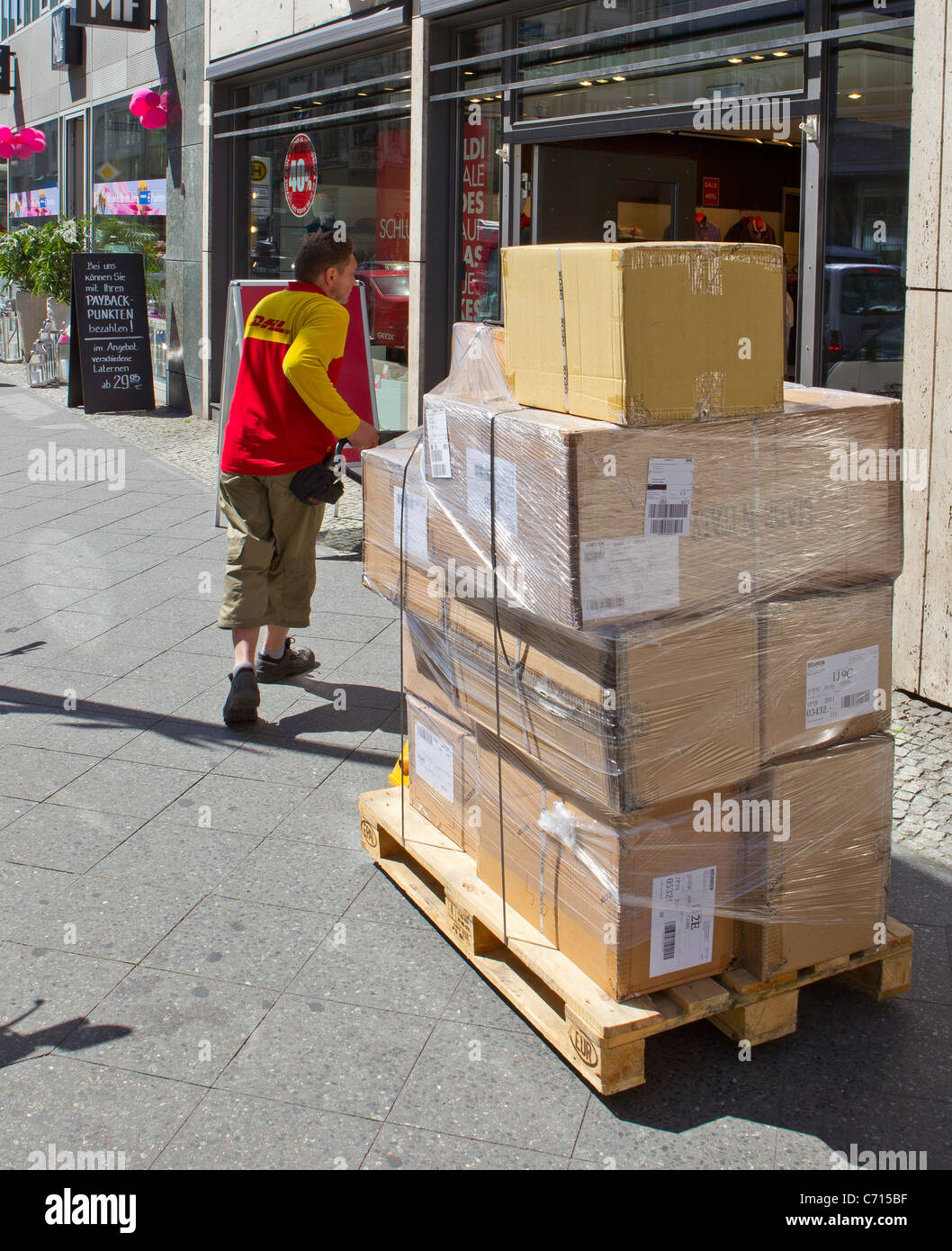 dhl courier deliver delivery boxes packages street - Stock Image